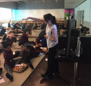 Physiotherapist Tania Amorim discusses some safe stretching techniques to a busy studio of new BA Contemporary Dance Students.